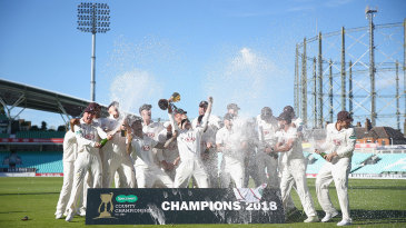 Surrey's players celebrate with the Championship trophy
