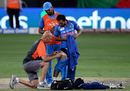 KL Rahul looks on as India physio Patrick Farhart attends to Kedar Jadhav's hamstrings, Bangladesh v India, Asia Cup final, Dubai, September 28, 2018