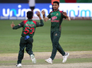 Mustafizur Rahman and Mehidy Hasan celebrate the wicket of MS Dhoni, Bangladesh v India, Asia Cup final, Dubai, September 28, 2018