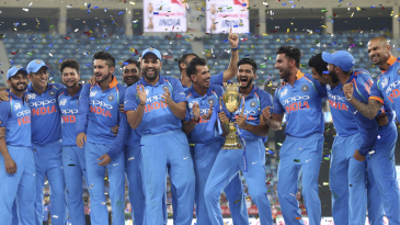 The Indian team celebrates winning the seventh Asia Cup title