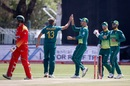 Wiaan Mulder celebrates with his team-mates, South Africa v Zimbabwe, 1st ODI, Diamond Oval, September 30, 2018