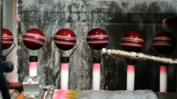 Lacquer is applied to balls in the Kookaburra factory in Moorabbin in Melbourne