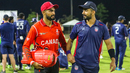 Trinbago Knight Riders team-mates Hamza Tariq and Ali Khan catch up after doing battle for their national sides, USA v Canada, ICC World Twenty20 Americas Sub Regional Qualifier A, Morrisville, September 22, 2018