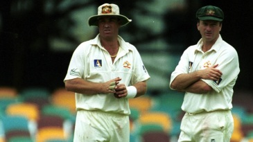 Shane Warne and Steve Waugh look on during a Test match