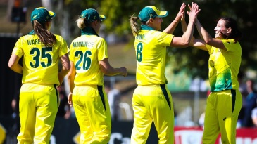 Megan Schutt celebrates a wicket with team-mates