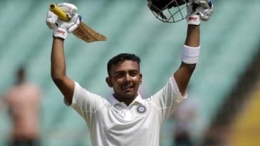 Prithvi Shaw raises his bat after a century on debut