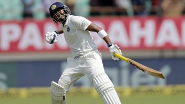Prithvi Shaw punches the air after a century on debut
