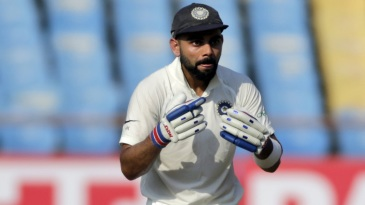 Virat Kohli gestures during his unbeaten half-century on Day 1