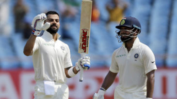 Virat Kohli soaks in the applause after bringing up his 24th Test ton even as Rishabh Pant watches