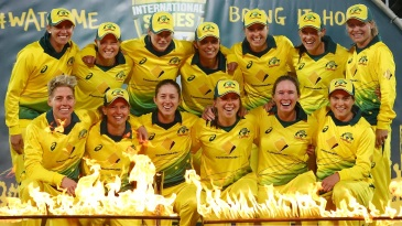 Australia women pose with the trophy after the series win