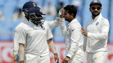 Kuldeep Yadav celebrates the wicket of Roston Chase