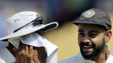 Virat Kohli and Ravindra Jadeja laugh as they walk off after India's win