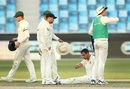 Mitchell Starc goes down with a cramp towards the end of play, Pakistan v Australia, 1st Test, Dubai, 1st day, October 7, 2018