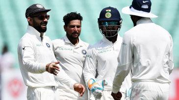 Virat Kohli, Rishabh Pant and Kuldeep Yadav celebrate a wicket
