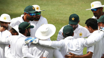 Sarfraz Ahmed calls his team into a huddle after they set Australia a daunting target