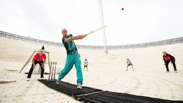 Chris Lynn hits out on the radio telescope in Parkes, NSW, re-enacting a scene from the movie <i>The Dish</i>