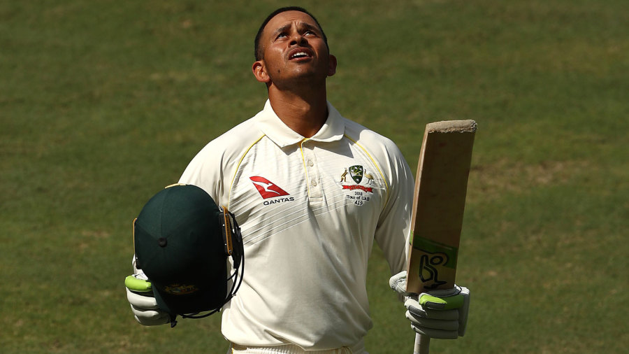 Usman Khawaja looks to the heavens after making his first century in Asia