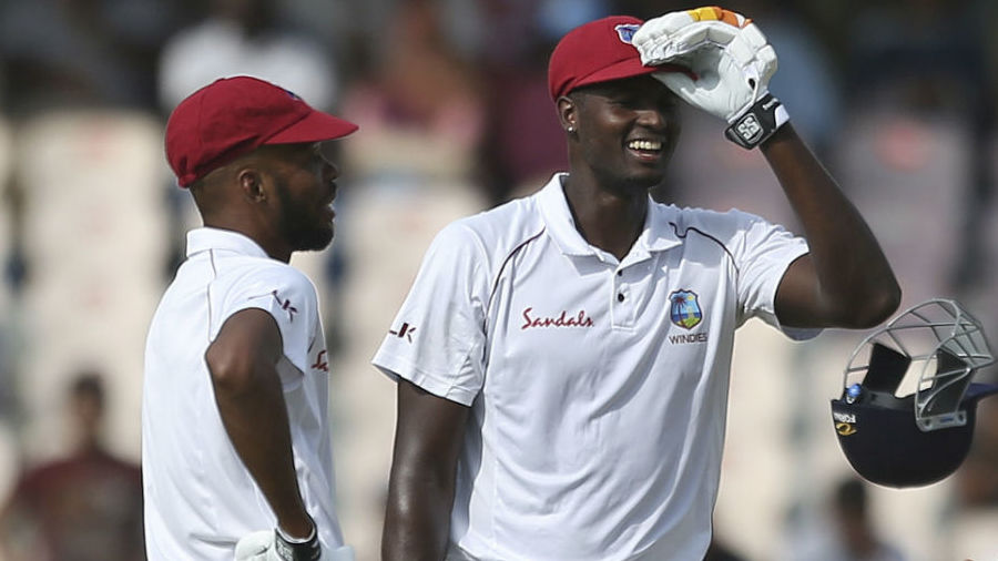 Jason Holder shares a laugh with Roston Chase