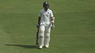 Ajinkya Rahane walks back after being dismissed