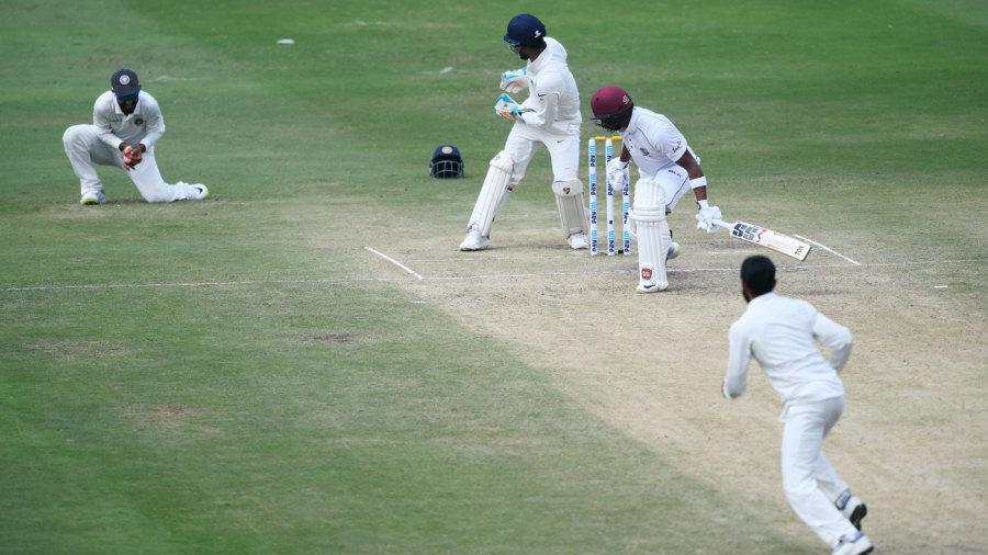 Ajinkya Rahane holds on to a catch at slip