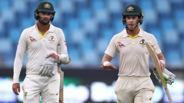 Tim Paine and Nathan Lyon walk back after salvaging a draw for Australia