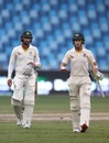 Tim Paine and Nathan Lyon walk back after salvaging a draw for Australia, Pakistan v Australia, 1st Test, Dubai, 5th day, October 11, 2018