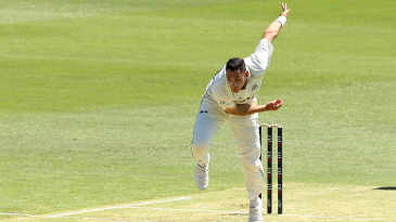 Scott Boland powers through the bowling crease