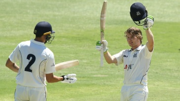 Will Pucovski raises his bat after bringing up his hundred