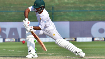 Fakhar Zaman stretches forward to defend