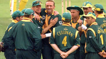 Shaun Pollock and Allan Donald celebrate a wicket with their team-mates