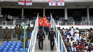 Eoin Morgan leads England out into the field