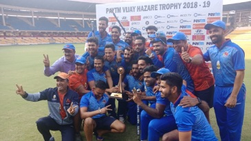 The victorious Mumbai players celebrate with the trophy
