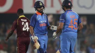 Virat Kohli and Rohit Sharma share some glove love