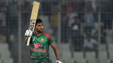 Imrul Kayes raises his bat after reaching a hundred