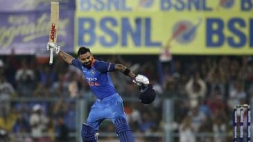 Virat Kohli celebrates a hundred