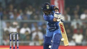 Virat Kohli opens the face of the bat as he meets the ball