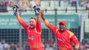 Brendan Taylor and Hamilton Masakadza celebrate a wicket
