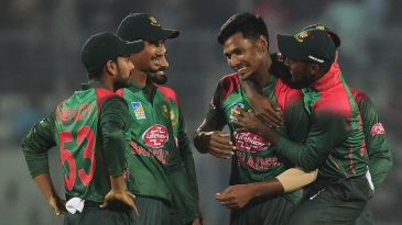 Mustafizur Rahman is congratulated by his team-mates