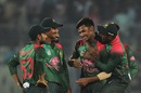 Mustafizur Rahman is congratulated by his team-mates, Bangladesh v Zimbabwe, 1st ODI, Mirpur, October 21, 2018