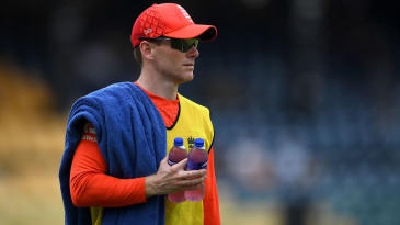 Rested captain Eoin Morgan carries the drinks