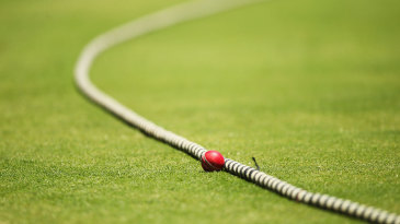 The ball lies by the boundary rope
