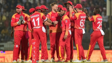 The Zimbabwe fielders celebrate a wicket