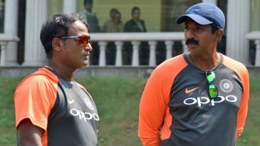 India head coach Ramesh Powar and fielding coach Biju George have a chat