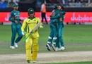 Alex Carey walks back as Mohammad Hafeez and Sarfraz Ahmed celebrate, Pakistan v Australia, 2nd T20I, Dubai, October 26, 2018