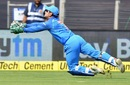 MS Dhoni times his dive to perfection and completes a difficult catch, India v West Indies, 3rd ODI, Pune, October 27, 2018