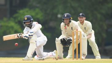 Kaushal Silva sweeps on the way to a half-century