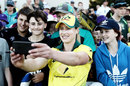Ellyse Perry takes a photo with fans after the game, Australia v New Zealand, Brisbane, October 1, 2018
