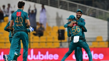Pakistan's players get together to celebrate a wicket