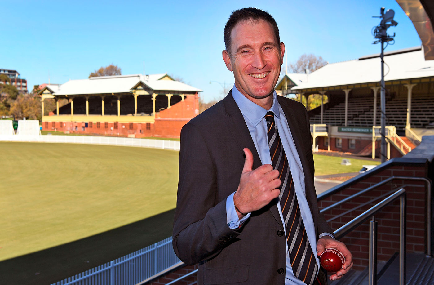 James Sutherland gives a thumbs-up sign to reporters after announcing his decision to step down as Cricket Australia CEO
