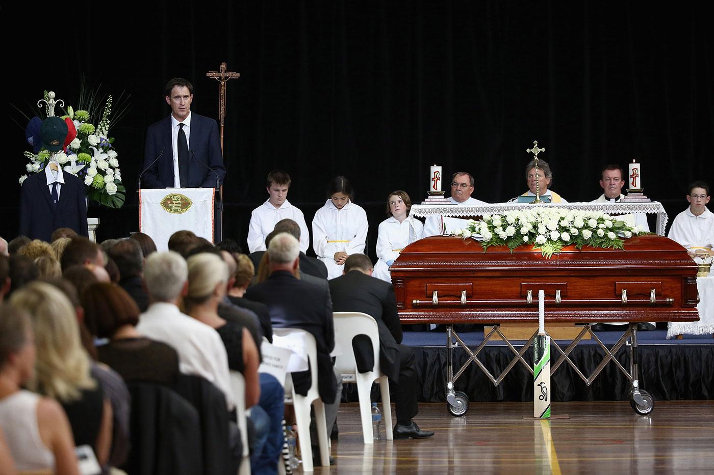 Sutherland speaks at the funeral of Phillip Hughes in Macksville, 2014